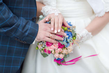Wedding hands. Newly wedded showing own hands with wedding rings 版權商用圖片