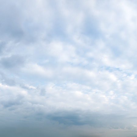 break in: white clouds on blue sky background