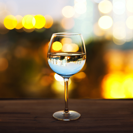 close-up of wineglass with copyspace and abstract lights background Reklamní fotografie