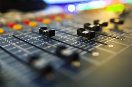 Part of an audio sound mixer with buttons and sliders. with shallow depth of field Reklamní fotografie