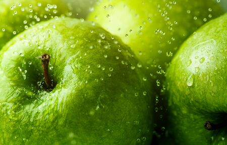 close up food: Green apples with water droplets Background, shallow depth of field.