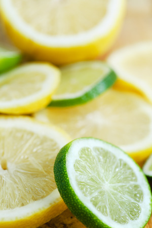 citrous: Fresh lime and lemon Slices of various citrus fruits with shallow depth of field background Stock Photo