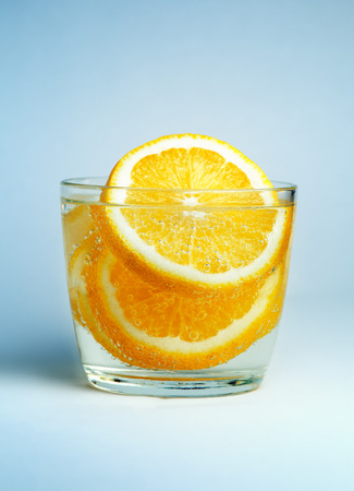 freigestellt: Glass of water with lemon with shallow depth of field