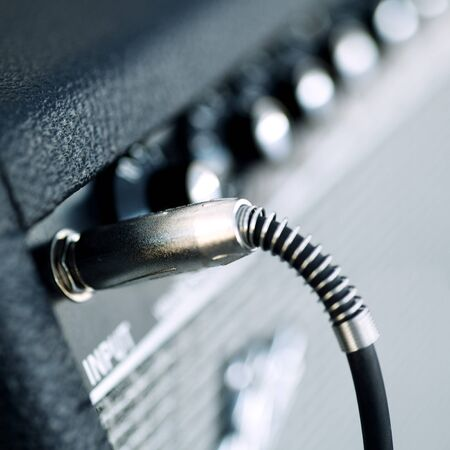 amp: Connectors are connected in audio inputs Guitar amplifier Stock Photo