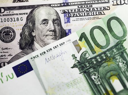 parity: dollar and euro notes. symbol differences euro dollar money background closeup