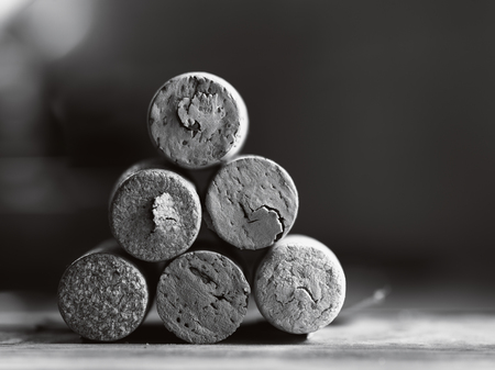 black  cap: stack of used wine corks black and white close-up with shallow depth of field Stock Photo