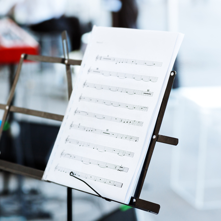 arts culture and entertainment: music notes on music stand
