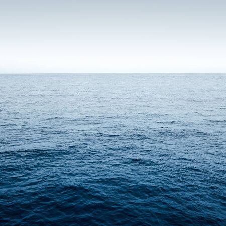 Blue Ocean with waves and clear blue sky 스톡 콘텐츠