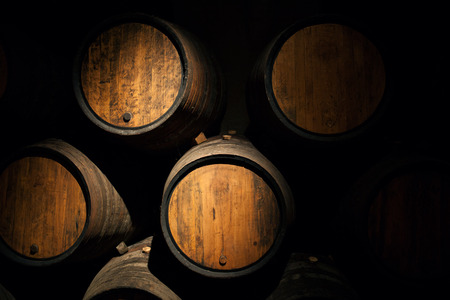 Wine barrels in a old wine cellar Wooden oak wine barrel