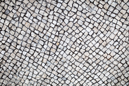 traditional portuguese street stone pavement Stone pavement texture Stock Photo