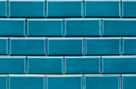 faience: Blue ceramic brick tile wall,background tiles on facade