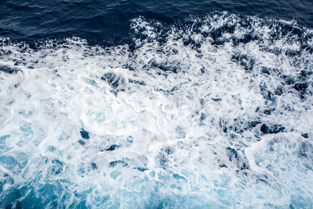 ocean wave: Ocean Wave breaking on a against cliff view from above sea foam Stock Photo