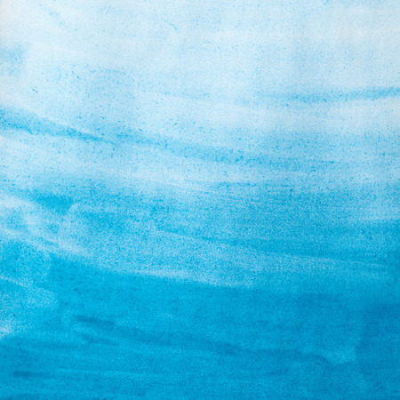 blue watercolor wash on paper texture. Abstract background 스톡 콘텐츠