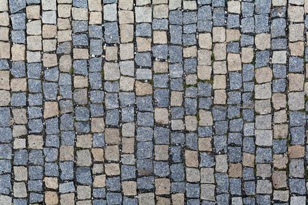 pavement: Stone pavement texture. Granite cobblestoned pavement background. Abstract background of old cobblestone pavement close-up. Stock Photo