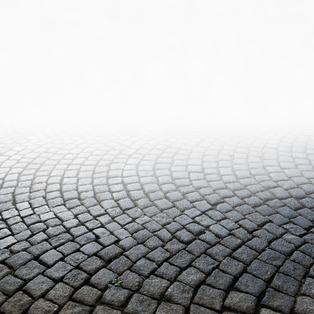 pavement: stone pavement Grey brick stone street road Abstract background of old cobblestone pavement close-up Selective focus Stock Photo