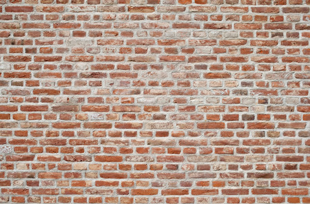 Red brick wall Background of old vintage brick wall