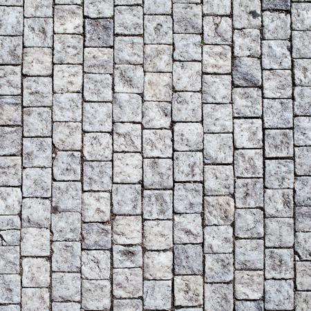 pave: Stone pavement texture. Granite cobblestoned pavement background. Stock Photo