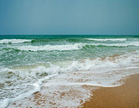 ocean wave: ocean coast and blue sky, ocean wave,sandy beach and blue sky Stock Photo