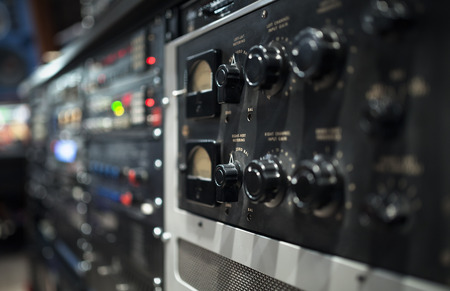 audio mixer: Professional audio sound equipment with buttons and sliders . Selective focus. Stock Photo
