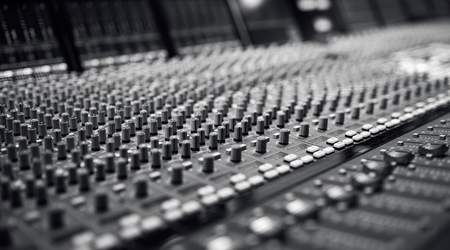 Audio Mixing Board,Professional audio mixing console with faders and adjusting knobs,TV equipment Black and White, selective focus Reklamní fotografie