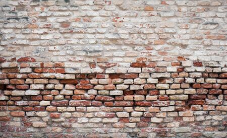 blasted: Old multi colored brick wall,stone in Venice, Italy Stock Photo