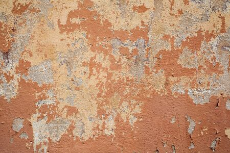 chipped: Old wall background Damaged plaster,orange painted cracked wall