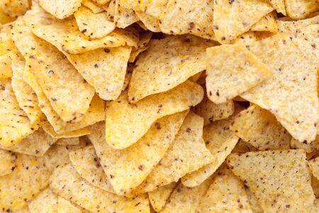 nacho chip: nachos yellow tortilla chips background Close-up