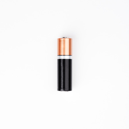 alkaline: One AA Alkaline battery on white background Stock Photo