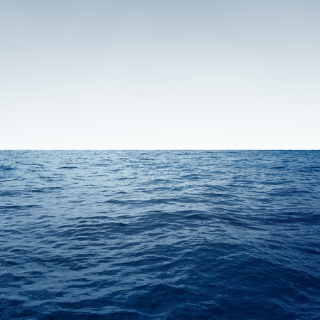 Ocean with waves and clear blue sky Water background