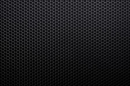 metal grid: black metal grid background with circles