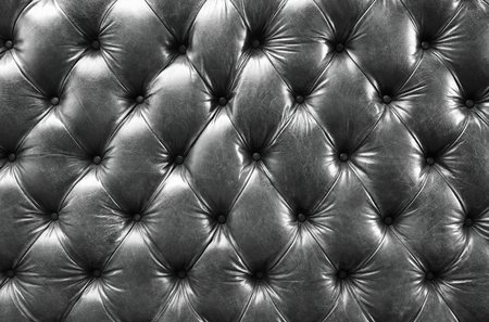 padding: texture of creased leather upholstery black and white