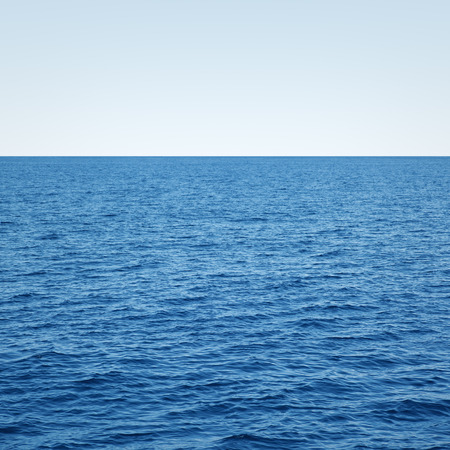 ocean waves: blue ocean waves and clear blue sky Stock Photo
