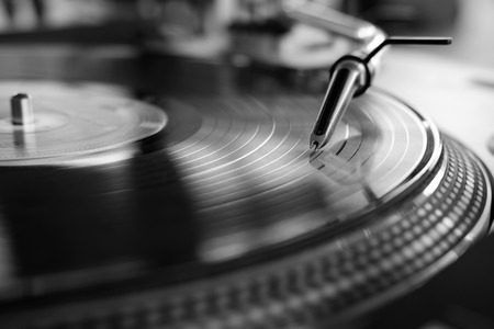 vinyl player,analog sound technology for dj playing digital music,close up audio equipment for disc jockey black and white Archivio Fotografico