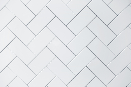 witte keramische steen tegel muur achtergrond Stockfoto