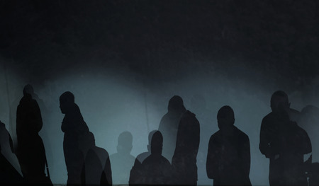 photography of abstract silhouette mysterious people in a dark background