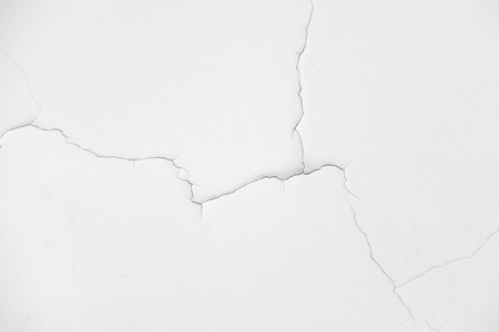 black and white wall with cracks