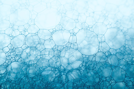 foam blue texture soap bubbles on the water abstract background