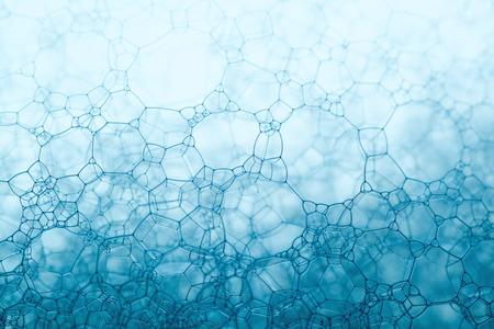 Schuim blauwe textuur zeepbellen op het water abstracte achtergrond