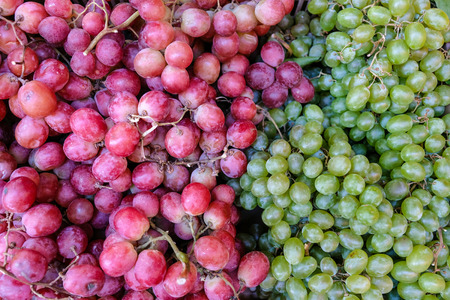 red wine grapes background, white grapes,background in a local market bunch of grapes ready to eat Banco de Imagens