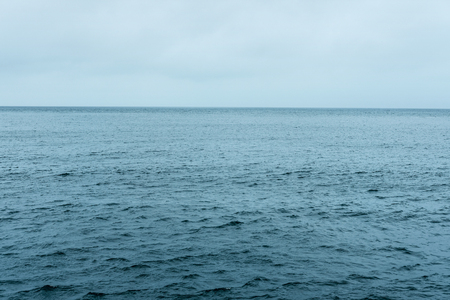 cold sea and cloudy sky waves in Pacific Ocean