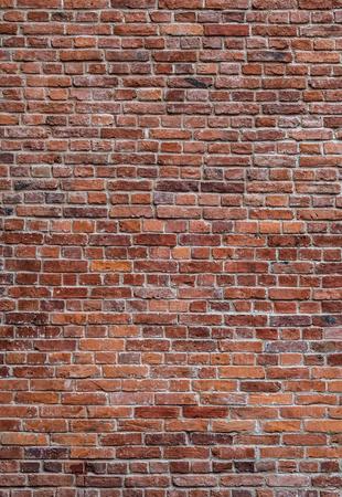 Fondo de textura vertical de pared de ladrillo rojo antiguo Foto de archivo