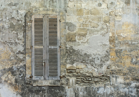 old window with wooden lattice shutters on old wall Banco de Imagens