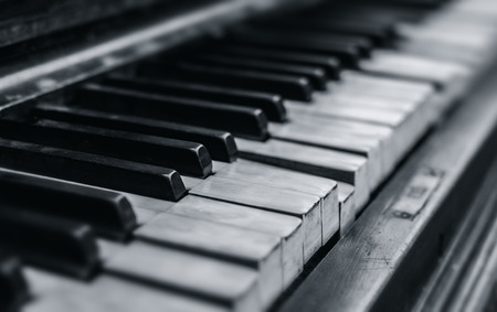 Old piano keyboard close up background, Selective focus, black and white