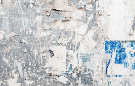 old torn paperpaper posters on grunge old wall texture and background