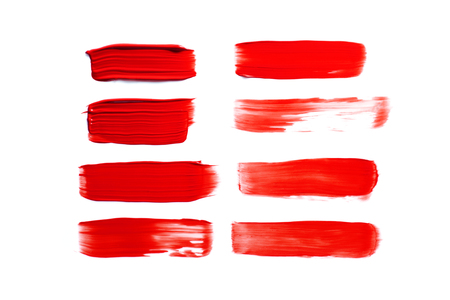 set of red brush strokes isolated on white background