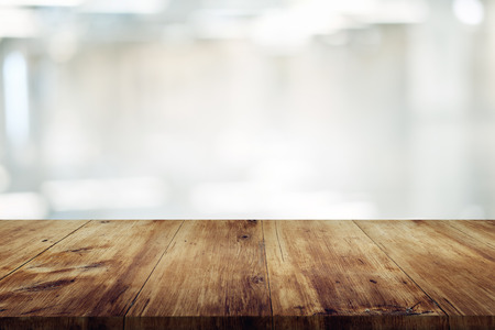 empty wooden table on abstract blurred background of coffee shop or kitchen for display or montage your products.mock up for display of product Reklamní fotografie