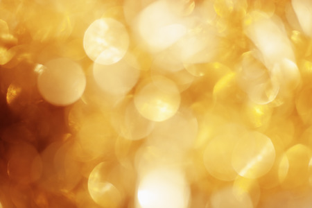 yellow gold glitter abstract blurred bokeh defocused lights background