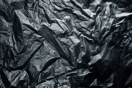 black crumpled plastic bag close up texture  background