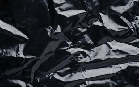 schwarze Plastiktüte Nahaufnahme Textur Hintergrund