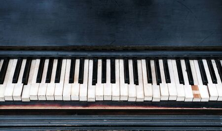 old piano keyboard close up background
